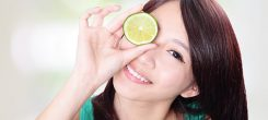 woman holding kiwi fruit cover her eyes